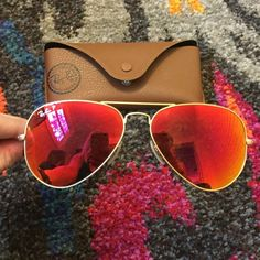 Ray Ban Polarized Aviator Polarized orange/red mirrored aviator. Worn once or twice, kept in ray ban holder with cleaning cloth. Ray-Ban Accessories Sunglasses