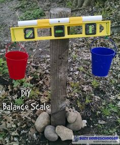 DIY outdoor balance scale for kids - add some science to your backyard!
