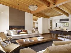 Sugar Bowl Residence John Maniscalco Architecture  pitched roof, wood ceiling, timbers, long fireplace living room