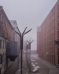 Rotermann, Tallinn. Repurposed old industrial quarters in a harmonious ensemble with new office and apartment buildings. The fog lets it feel bigger and more powerful than it already is.