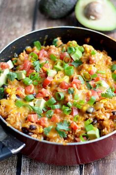 One Pot Cheesy Chicken Taco Rice.  This 30 minute, one pot meal will become a quick family favorite!