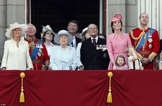 Members of Britain's Royal family from left, Camilla, the Duchess of Cornwall, Prince Charles, Princess Eugenie, Queen Elizabeth II, background Timothy Laurence, Princess Eugenie, Prince Philip, Kate, the Duchess of Cambridge, Princess Charlotte, Prince George and Prince William watch a fly past as they appear on the balcony of Buckingham Palace, after attending the annual Trooping the Colour Ceremony in London