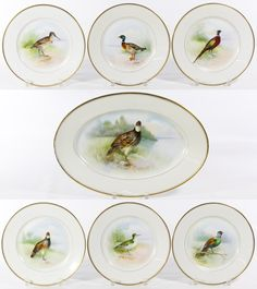 """Lot 409: F.R. Cross Bavarian Bird Platter and Plate Set; Having a """"Josephine Bavaria Favorite"""" mark in green and a FR Cross Chicago"""" mark in gold on the underside; each plate features a different bird"""