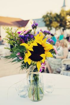 Colorful Sunflower, Fuchsia Orchid & Purple Statice with Greenery Mason Jar Centerpiece