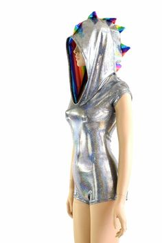 This item is made to order, please read all the way through the listing before purchasing!  This bodysuit is made of lycra spandex in a sparkling silver holographic with rainbow striped spikes and hood lining. It shines and sparkles with every move you make! Cap sleeves, spiked down the back and down the full hood, and boy cut legs. Four way stretch for a figure forming fit. This bodysuit is unlined.     Womens Sizing (See below for instructions on where measurements should be taken)  Extra…