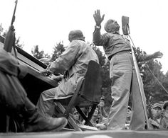 Al Jolson entertains U.S. troops at Pusan Stadium during his visit to the fighting front. He died shortly after his return from Korea where he gave of his talent untiringly and unceasingly. He made the trip at his own expense. September 17, 1950. Kondreck. (Army)