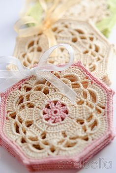 These are just the prettiest granny squares I have seen in a long time.  May have to work these into a pretty crocheted scarf for Christmas. Crochet coasters sets by Anabelia.