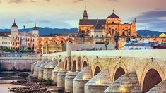 The Long Bridge of Volantis - Roman Bridge in Cordoba, Spain Cadiz, Granada, Beautiful Places To Visit, Places To See, Monuments, Best Cities In Spain, Angkor Vat, Costa, Spanish Towns