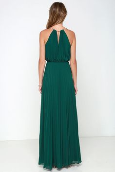 From the first dance to the last, everything will be an utter dream in the Bariano Melissa Dark Green Maxi Dress! A stretchy gold coil necklace (with adjustable lobster clasp closure) creates a sultry halter neckline supporting pleated dark green chiffon. Sleeveless bodice billows into an elastic waistband before descending into an unforgettable maxi length skirt. Triangular back keyhole. Fully lined in dark green satin. Self: 100% Polyester. Lining: 97% Polyester, 3% Spandex. Hand Wash…