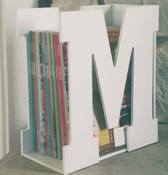 "Best DIY Ideas Jewelry: You won't believe how quick & easy it is to make this darling ""M is for Magazine"" rack using precut wood letters & a piece of scrap wood! A stylish & original gift idea that is sure to be a hit! Wood Crafts, Fun Crafts, Diy And Crafts, Decor Crafts, Diy Projects To Try, Craft Projects, Project Ideas, Craft Ideas, Diy Magazine Holder"