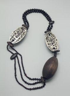 """""""Mastkraal"""" by Francis Wllemstijn  / New silver, jet, garnets, bog oak, pine, brass."""