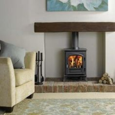 Wood burner with wooden mantle and brick base. , Wood burner with wooden mantle and brick base. Small Wood Burning Stove, Small Stove, Small Log Burner, Gas Log Burner, Log Burner Living Room, Home Living Room, Wood Burner Fireplace, Brick Fireplaces, Electric Fireplaces