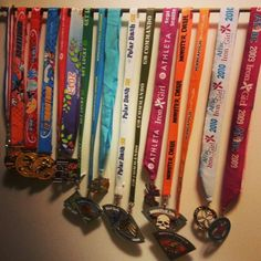 I LOVE the awesome metal medal hangers, but not for $60+. Just buy a curtain rod for $3.50 @ Target and organize your bling!