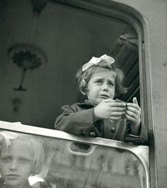 "This sad child is one of 669 Jewish Czechoslovakian children who were permitted to leave their country and families on the ""Kindertransport"", a train bound for Britain. This event was facilitated by Sir Nicholas Winton. Photo by Werner Bischof."