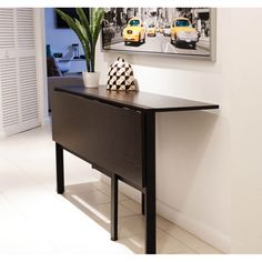 Create a cute area full of functional appeal with this Tokyo drop-leaf dining table by Matrix. This rectangular table easily adjusts to accommodate available space in your home, making it an ideal inv