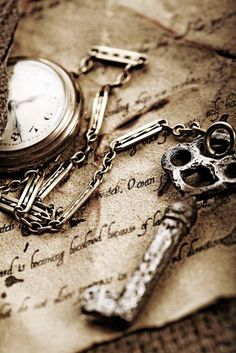 I love old keys, hand-written messages, and pocket watches.  They're like little windows to a world that's been a bit forgotten, and that makes them seem all the more intriguing.