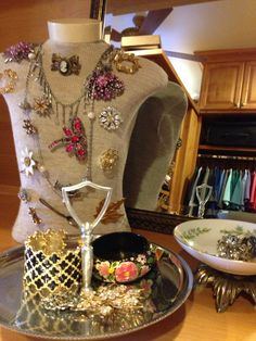 Broaches, bracelets and bowls from #Goodwill.  #thrift #home #jewelry