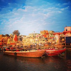 Colourful boats & buildings by the Ganges River, India.   ••••••••••••••••••••••••••••••••••••••••• WorldlyNomads.com •••••••••••••••••••••••••••••••••••••••••