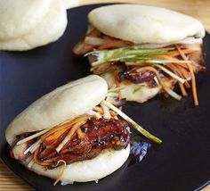 Steamed bao buns: Fill these steamed Chinese bread rolls with BBQ pork and pickled vegetables for a perfect Chinese New Year party nibble