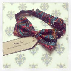 Men's bow tie handmade from turquoise and red paisley print, by Beau tie