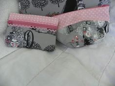 and the little accessory bags - an in the hoop zippy bag from ZippyDesignz (so quick and easy) and a zip pouch pattern by Amy Butler
