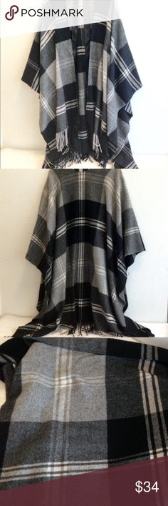 Wool Cashmere Plaid Blanket Boho Fringed Poncho Mostly Grey and Black Wool and Cashmere Plaid Shawl Poncho. This is pretty long, and really warm for a poncho. Good condition with minor pilling. This is more like a thin wool blanket that a sweater Poncho, so retains its shape. Cladia Nichole Jackets & Coats