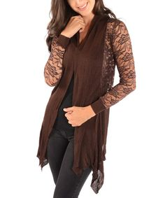 For instant ensemble enhancement, pop on this breezy number. With its neutral hue and lovely lace sleeves, this chic cardi brings sophisticated, trend-savvy style to any getup. 60% acrylic / 40% polyesterMachine wash; dry flatImported