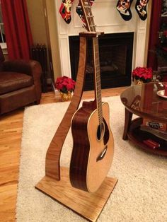 Hanging Guitar Stand that will fit into just about anyone's design. Beautiful!
