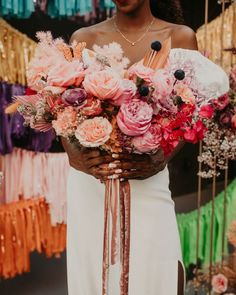 Large dark and light pink bridal bouquet wild dried palm and butterflies | Image by Nikk Nguyen Photo