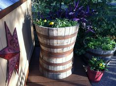 With the use of whiskey barrels and some plants, created a beautiful rustic look...