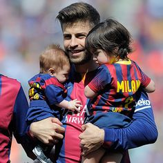 Gerard Pique holds his two sons Sasha and Milan at his soccer match in Barcelona, Spain on April 18.