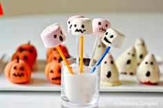 Halloween marshmallow pops, chocolate-covered ghost strawberries, and marzipan pumpkins.