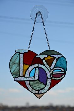 Heart suncatcher Stained glass window hanging Glass garden decor Love suncatcher – Stained Glass and Glass Art Techniques Stained Glass Ornaments, Stained Glass Birds, Stained Glass Suncatchers, Faux Stained Glass, Stained Glass Lamps, Stained Glass Designs, Stained Glass Panels, Stained Glass Projects, Stained Glass Patterns