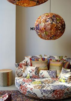 The floral pattern is too busy for my tastes but I like the flow of the room and the round furniture.