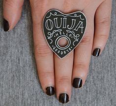 When I was a kid I was told that Ouija boards were portals to Hell. That used to really freak me out, until I realized that I don't believe in Hell.   Now that I'm past all that superstitious mumbo-jumbo, I'm completely charmed by the jewelry of UK punk and Occult artist Bex Ling which features Ouija boards, crystal balls, seeing eyes, palmistry, and the hands of fortune tellers. Not one piece of it emits a whiff of bad juju to me.   Her jewelry, sold under her company Misfit Makes, is cr...