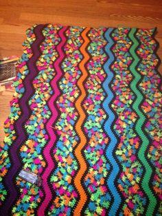 """Red Heart's """"black light yarn"""" crochet blanket"""