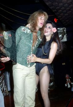 David Lee Roth greeting the house help at the Warner Brothers launch party of their album at an LA strip club 1978 <--- The look on that girl's face though...X'D