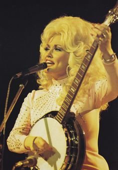 Dolly Parton (Solo country vocalist & multi-instrumentalist. She has won 8 Grammys, 2 Academy Award nominations, 10 Country Music Choice Awards, 7 Academy of Country Music Awards, 3 American Music Awards, & Country Music's Entertainer of the Year. She has penned over 3,000 songs & has 46 Grammy nominations. Inducted into the Country Music Hall of Fame in 1999, & starred in musical films 9 to 5, Joyful Noise, & The Best Little Whorehouse in Texas)