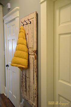 """diy coat rack from reclaimed door rustic. My hubby dug an 8 glass panel door out of the attic at the rental. He """"thinks"""" its going in the trash. Silly man :)"""