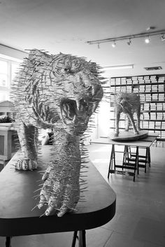 Tiger and Cheetah Sculpture made entirely of Wire Coat hangers by David Mach