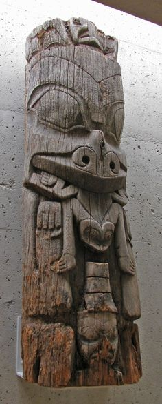 Red cedar totem pole fragment. Culture: Haida: Kunghit From Ninstints, Skunggwai