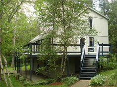 MJ Peterson Real Estate -- 29 Woodstock Rd. CONCORD, NY -- Four bedroom two and a half bath home in Craneridge. Home has a small garage, fireplace, large deck and family room. Woodland community across from KB Skiing area. Community has a playground, sports field and picnic shelter for residents use. Tenant is responsible for lawn car and snow removal. Tenant pays own utilities. A pet is ok.
