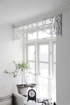 Wrought Iron scroll work as a window treatment via Tre Engler