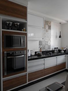sleek kitchen with personality, tile, drawers, wall oven, neutrals with contrast