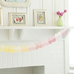 With Easter approaching, this egg garland—made of paint chips!—is a great way to decorate any room. #DIY #Craft