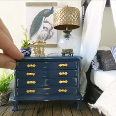 New today.... minature royal navy blue chest of drawers with gold bow draw pulls