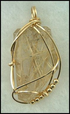 rutilated quartz crystal wrapped in 14kt gold filled wire