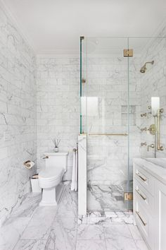 carrera marble bathrooms shaker cabinets two piece toilet hinged glass door alcove shower white tiles grey backsplash contemporary design of Fabulous Carrera Marble Bathrooms to be Awestruck By