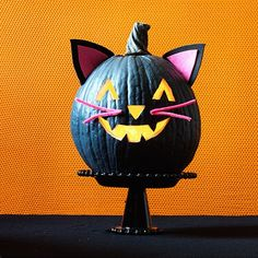 A black cat and a jack-o'-lantern all in one, this easy craft combines two Halloween favorites into one cute pumpkin.