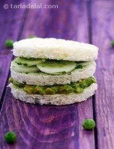 A triple-decker feast prepared with buttered bread roundels packed with a green peas mixture and refreshing cucumber slices. You will love the blend of crunchy cucumber and nutty green peas laced with mayonnaise and chilli sauce as you bite into the sumptuous green peas and cucumber sandwich.